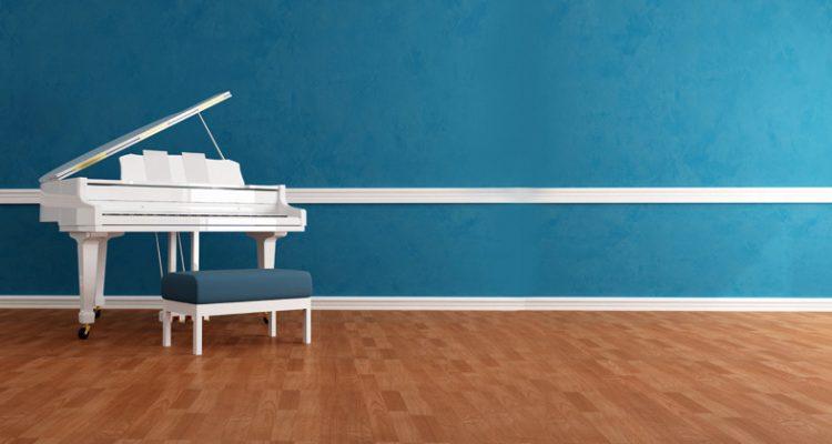 white gran piano in blue interior